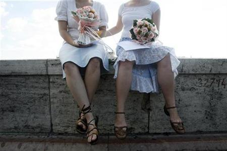 Lesbians wait for their unofficial marriage ceremony by the river Danube in Budapest July 14, 2007. REUTERS/Laszlo Balogh