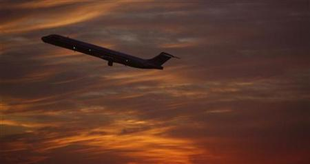A plane takes off from Dallas / Fort Worth international Airport in Texas at sunset February 19, 2007. REUTERS/John Gress