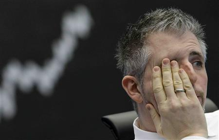 Trader Dirk Mueller reacts as he sits in front of the German DAX index board at Frankfurt's stock exchange January 22, 2008. REUTERS/Kai Pfaffenbach