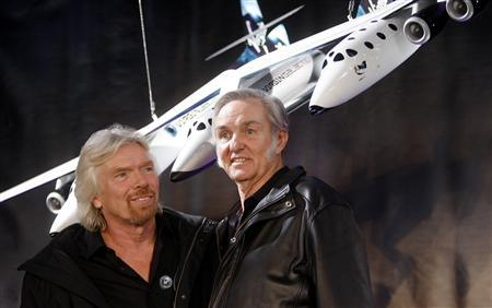 Entrepreneur Richard Branson (L) and aircraft designer Burt Rutan display Virgin Galactic and Scaled Composites' new WhiteKnightTwo and SpaceShipTwo aircrafts in New York January 23, 2008. REUTERS/Chip East