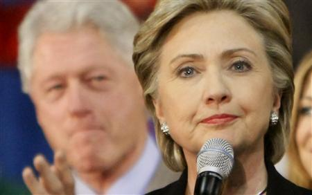 Democratic presidential candidate Sen. Hillary Clinton (D-NY) speaks to supporters as her husband, former president Bill Clinton, listen at a rally in Las Vegas, January 18, 2008. In 1992 Bill Clinton vowed Americans would get ''two for the price of one'' if they elected him with wife Hillary at his side. Now it is two against one as the Clintons gang up on Barack Obama in the Democratic presidential race. REUTERS/Rick Wilking
