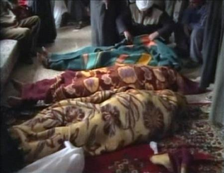 A video provided to Reuters on March 21, 2006 by Hamourabi Human rights group shows covered bodies, which Hamourabi says, are of a family of 15 shot dead in their home in Haditha, in western Anbar province, Iraq. A U.S. Marine officer accused of destroying evidence in the 2005 killings of 24 Iraqi civilians in Haditha was arraigned on Wednesday by a military judge who set his court martial for May. REUTERS/Hammurabi Organisation via Reuters TV