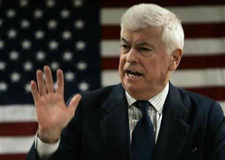 Senator Christopher Dodd (D-CT) speaks to supporters during a campaign rally stop at the Pella town hall in Pella, Iowa, December 5, 2007. Dodd, the chairman of the Senate Banking Committee, is proposing to set up a government-sponsored company that would buy distressed mortgages in an effort to save Americans from foreclosure. REUTERS/Carlos Barria