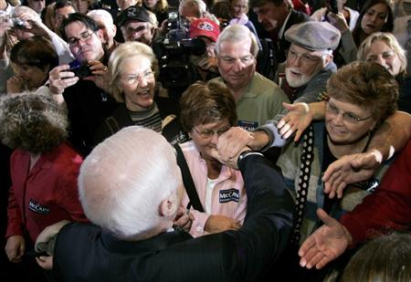 Supporters of Republican presidential candidate John McCain crowd closer for a handshake at a campaign stop in Fort Walton Beach, Florida, January 22, 2008. REUTERS/Mark Wallhesier