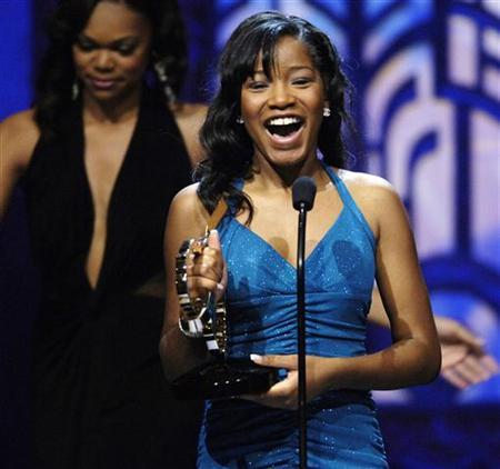 Actress Keke Palmer celebrates her award for Outstanding Actress in a Leading Role for her performance in the film ''Akeelah and the Bee,'' during the 2006 Black Movie Awards in Los Angeles October 15, 2006. Palmer has joined Ice Cube in his untitled inspirational sports drama for Dimension Films. REUTERS/Chris Pizzello