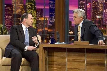 Republican presidential candidate and former Arkansas Governor Mike Huckabee (L) is interviewed by talk show host Jay Leno during a taping of the ''Tonight Show with Jay Leno'' in Burbank, California January 2, 2008. Leno got the last laugh Wednesday in his legal battle with the creator of numerous joke books filled with stolen gags and punch lines. REUTERS/Paul Drinkwater/NBC/Handout