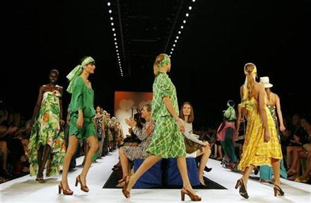 Models present creations from the Diane Von Furstenberg Spring 2008 collection during New York Fashion Week September 9, 2007. A top fashion designer sued Target Corp on Thursday for copyright infringement and other claims, saying the discount store is selling dresses with a print that is nearly identical to its ''spotted frog design.'' REUTERS/Keith Bedford