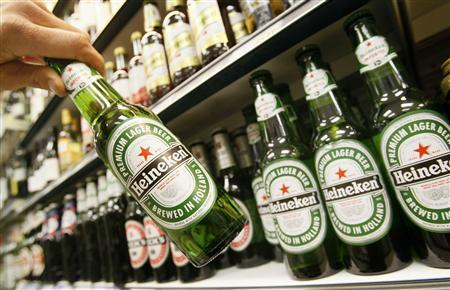Bottles of Heineken beer are displayed for sale at an off-licence store in central London January 24, 2008. REUTERS/Toby Melville