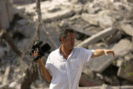 Lebanese filmmaker Philippe Aractingi  is seen on the sets of his film ''Under The Bombs'' in this undated publicity photo. Eighteen months after the outbreak of Israel's war with Hezbollah guerrillas in Lebanon, filmmakers from both countries have brought movies conveying frustration over the conflict to the Sundance Film Festival. REUTERS/Handout