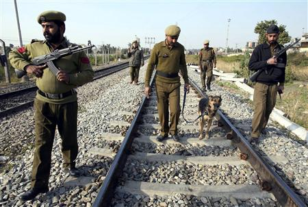 Security personnel patrol on railway tracks ahead of the Republic Day celebrations in Jammu January 25, 2008. France's President Nicolas Sarkozy will be the chief guest at India's 59th Republic Day celebrations on Saturday. REUTERS/Amit Gupta