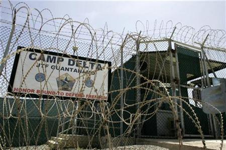 The front gate of Camp Delta is shown at the Guantanamo Bay Naval Station in Guantanamo Bay, Cuba September 4, 2007. This photo has been reviewed by the U.S. Military. A group of Sudanese released from the U.S. prison in Guantanamo Bay demanded cash payouts and an apology from the United States on Saturday, for mental and physical torture suffered during years spent in jail there. REUTERS/Joe Skipper