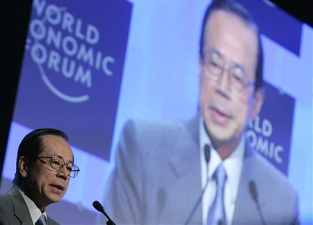 Japan's Prime Minister Yasuo Fukuda appears on a video screen as he addresses a session at the World Economic Forum (WEF) in Davos January 26, 2008. REUTERS/Stefan Wermuth