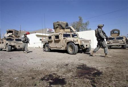 U.S. soldiers inspect the scene of a roadside bomb attack in Baghdad November 1, 2007. REUTERS/Thaier al-Sudani
