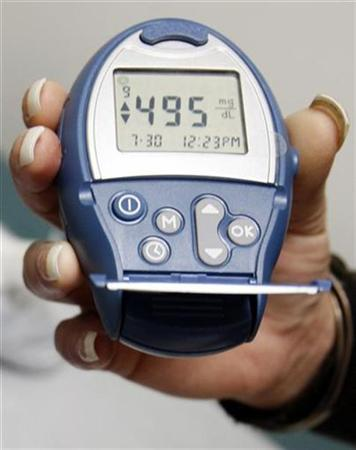 A type 1 diabetic patient displays her blood sugar level testing device at the J.W.C.H. safety-net clinic in downtown Los Angeles, July 30, 2007. REUTERS/Lucy Nicholson