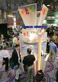 Visitors talk in front of an eBay kiosk during the 2007 International Consumer Electronics Show (CES) in Las Vegas, January 9, 2007. A New York state employee who had access to government-owned archives has been arrested on suspicion of stealing hundreds of historic documents, many of which he sold on eBay, authorities said on Monday. REUTERS/Steve Marcus