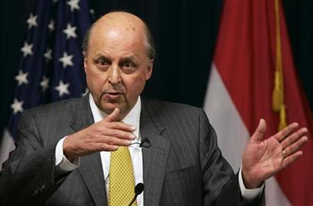 Deputy Secretary of State John Negroponte gestures as he speaks during a news conference in the Green Zone in Baghdad, December 2, 2007. The United States used waterboarding in terrorism interrogations but no longer does, Negroponte said in the Bush administration's most explicit confirmation of the technique's use. REUTERS/Ceerwan Aziz