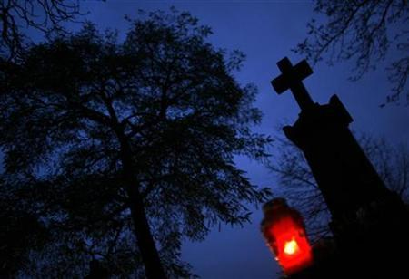 A candle burns at Powazki cemetery in Warsaw three days before All Saints day October 28, 2007. REUTERS/Peter Andrews