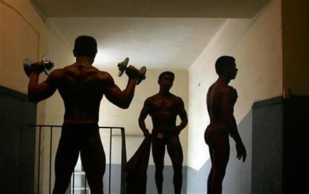 Body builders warm up before a competition in a file photo. REUTERS/Ahmad Masood