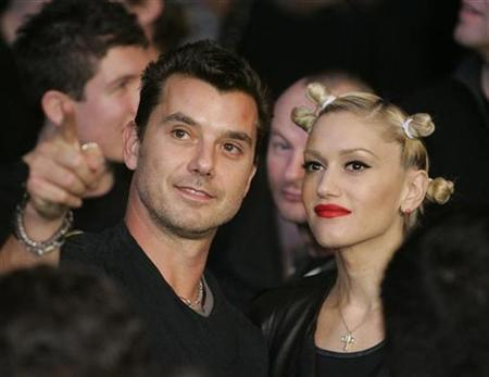 Musicians Gavin Rossdale (L) and Gwen Stefani attend the Ricky Hatton of England versus Floyd Mayweather Jr. of US, WBC welterweight title fight at the MGM Grand Garden Arena in Las Vegas, December 8, 2007. Stefani, whose 2004 album ''Love. Angel. Music. Baby.'' proved to be a breakout solo hit, is pregnant with her second child with husband Rossdale, according to several news reports on Tuesday. REUTERS/Steve Marcus