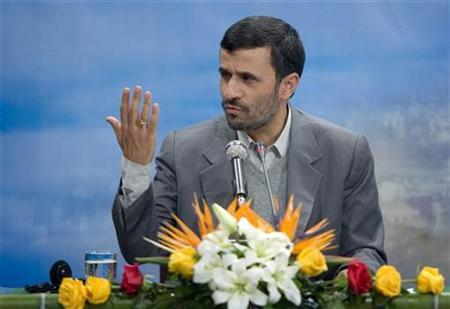 Iranian President Mahmoud Ahmadinejad speaks during a news conference in Tehran December 11, 2007. Iran is approaching the ''peak'' in its nuclear program and will not yield to Western pressure to halt its activities, Ahmadinejad said on Wednesday. REUTERS/Raheb Homavandi