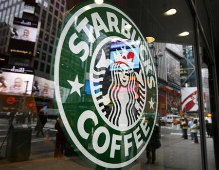 The Starbucks logo is seen outside a coffee-shop in New York's Times Square March 15, 2007. Starbucks Corp on Wednesday posted higher quarterly profit as the premium coffee seller works to revive its historically swift growth as it grapples with slower U.S. consumer spending, high milk prices and increased competition. REUTERS/Shannon Stapleton