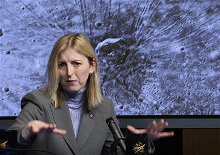 Louise Prockter, instrument scientist for the Mercury Dual Imaging System, John Hopkins University Applied Physics Laboratory, discusses the ''The Spider'' image, seen in the background, during a news conference at NASA Headquarters, in Washington January 30, 2008. REUTERS/NASA/Bill Ingalls/Handout