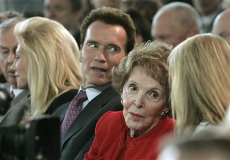 Former first lady Nancy Reagan and California Gov. Arnold Schwarzenegger attend the CNN/Los Angeles Times Republican presidential debate at the Ronald Reagan Presidential Library in Simi Valley, California January 30, 2008. REUTERS/Danny Moloshok