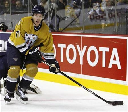 File photo shows Nashville Predators J.P. Dumont passing the puck past the Colorado Avalanche during second period NHL hockey action in Nashville, Tennessee, January 1, 2007. The Predators signed the forward to a four-year, $16-million contract extension the NHL club said on Friday. REUTERS/ M. J. Masotti Jr.