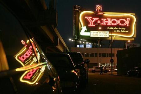 A Yahoo sign is pictured in San Francisco, California January 28, 2008. Google Inc so dominates the online search and advertising market that regulators are unlikely to challenge a merger of Microsoft Corp and Yahoo, two antitrust experts said on Friday. REUTERS/Robert Galbraith