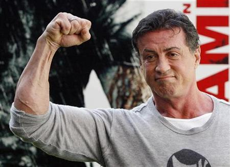 Actor Sylvester Stallone poses during a photocall to promote the movie ''Rambo'' in Madrid January 28, 2008. Stallone stars in this film which he also wrote and directed. REUTERS/Susana Vera