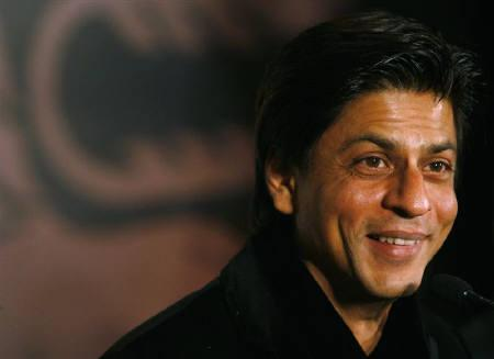 Shah Rukh Khan smiles during the promotional event of Diageo Radico Distilleries Pvt Ltd, a liquor manufacturing company, in New Delhi February 2, 2008. REUTERS/Vijay Mathur