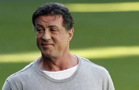 Actor Sylvester Stallone arrives for a photocall to promote the movie ''Rambo'' in Madrid January 28, 2008. REUTERS/Susana Vera/Files