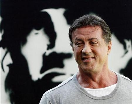 Sylvester Stallone poses during a photocall to promote the movie ''Rambo'' in Madrid January 28, 2008. REUTERS/Susana Vera