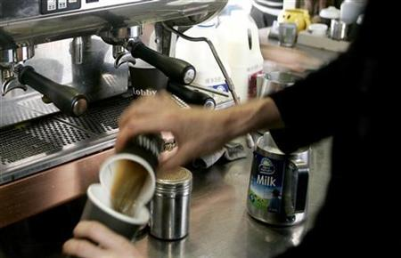 A barista makes a cup of coffee at a coffee stand in central Sydney September 13, 2007. Drinking coffee, using mobile phones or having breast implants is unlikely to cause cancer, according to a risk ranking system devised by an Australian cancer specialist to debunk popular myths. REUTERS/Mick Tsikas