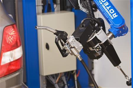 A car-fuelling robot is seen fuelling up a car in Emmeloord, central Netherlands, February 4, 2008. REUTERS/Michael Kooren