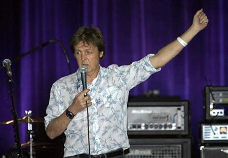 Paul McCartney answers journalists on the stage of Olympia concert hall in Paris October 22, 2007. REUTERS/Charles Platiau