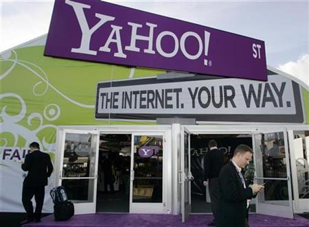 A man checks his cell phone outside the Yahoo! booth during the Consumer Electronics Show (CES) in Las Vegas, January 7, 2008. Business software units of Yahoo Inc and Google Inc are introducing beefed-up versions of their Web-based software that compete with Microsoft Outlook, offering yet another clue why Microsoft Corp made a $45 billion unsolicited bid for Yahoo. REUTERS/Steve Marcus