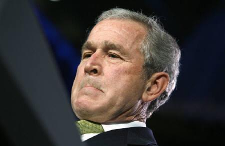 U.S. President George W. Bush looks down during remarks at a ceremonial swearing-in ceremony for the new Secretary of Agriculture Ed Shafer in Washington February 6, 2008. REUTERS/Kevin Lamarque