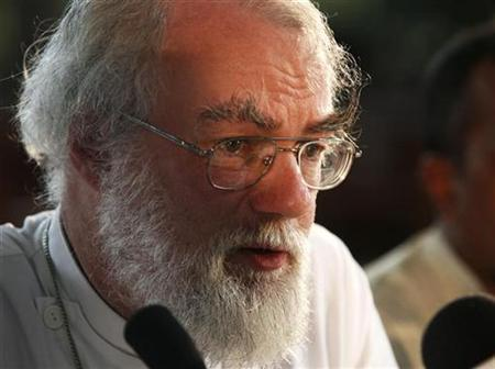 Archbishop of Canterbury Rowan Williams talks to the media as he concludes his four-day visit to Sri Lanka, in Colombo May 10, 2007. Williams, spiritual leader of the world's Anglicans, said on Thursday the introduction of some aspects of Islamic Sharia law in Britain was unavoidable. REUTERS/Anuruddha Lokuhapuarachchi