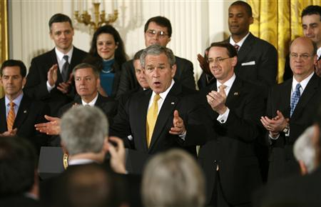 U.S. President George W. Bush speaks about pending presidential nominees in the East Room of the White House in Washington February 7, 2008. Behind Bush are nominees and members of Congress. REUTERS/Kevin Lamarque