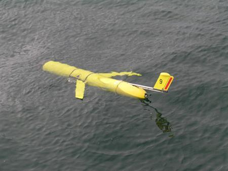 A seagoing flider is seen on the ocean surface before it descends to begin a mission. The glider, which uses heat energy from the ocean to propel itself, is the first ''green'' robot to explore the undersea environment, U.S. researchers said on Thursday. REUTERS/Mark Baumgartner/Woods Hole Oceanographic Institution/Handout