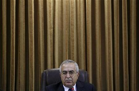 Palestinian Prime Minister Salam Fayyad attends a cabinet meeting in the West Bank city of Ramallah February 4, 2008. REUTERS/Loay Abu Haykel