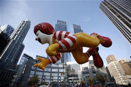 The Ronald McDonald balloon makes its way along the Macy's Thanksgiving Day Parade route through Columbus Circle in New York November 22, 2007. McDonald's Corp, the world's largest fast-food chain, said on Friday that sales at restaurants open at least 13 months rose 5.7 percent globally in January, but sales growth in the U.S. lagged. REUTERS/Brendan McDermid