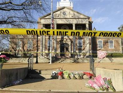 A crime scene tape cordons off Kirkwood City Hall in Missouri February 8, 2008. REUTERS/Tim Parker