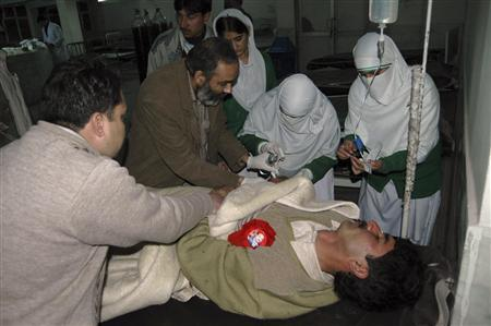 Medics tend to a wounded man in a hospital in Peshawar, after a bomb attack in Charsadda, February 9, 2008. REUTERS/Ali Imam
