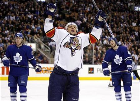 Florida Panthers forward Richard Zednik (C) celebrates his goal in front of Toronto Maple Leafs forwards Matt Stajan and Boyd Devereaux (R) during the first period of their NHL hockey game in Toronto, February 5, 2008. Zednik was in stable condition in hospital on Monday following emergency surgery after his neck was slashed by a team mate's skate during Sunday's defeat by the Buffalo Sabres. REUTERS/ Mike Cassese