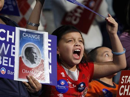 A young supporter of Democratic presidential candidate Senator Barack Obama cheers during a rally in Alexandria, Virginia February 10, 2008. REUTERS/Carlos Barria