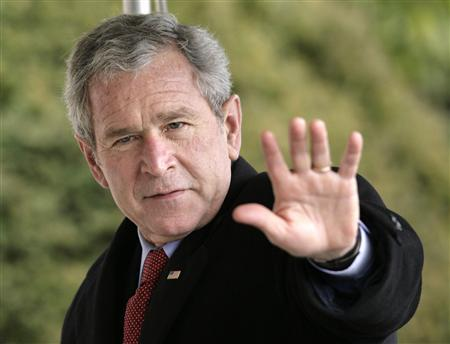 U.S. President George W. Bush waves as he walks on the South Lawn of the White House upon his arrival in Washington from Camp David February 10, 2008. Bush said on Monday the U.S. economy was currently facing heightened risks, but its foundation was solid and its long-term outlook was strong. REUTERS/Yuri Gripas