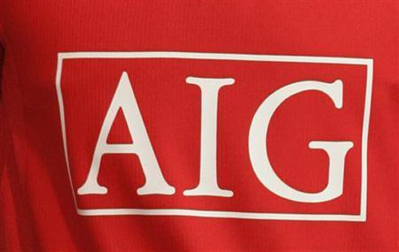 A Manchester United shirt with the club's sponsor AIG is seen April 6, 2006. American International Group Inc on Monday revealed that its auditors had questioned whether it properly valued its derivatives portfolio, raising new questions about accounting practices at the world's largest insurance company. REUTERS/Phil Noble