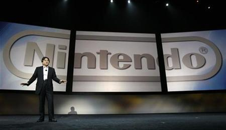President of Nintendo Co., Ltd Satoru Iwata speaks on stage during the E3 Media and Business Summit in Santa Monica, California July 11, 2007. Nintendo Co Ltd sold 1.08 million units of its ''Super Smash Bros. Brawl'' software in 11 days since its January 31 launch in Japan, reaching the 1 million mark faster than any other Wii game, a game magazine publisher said. REUTERS/Mario Anzuoni